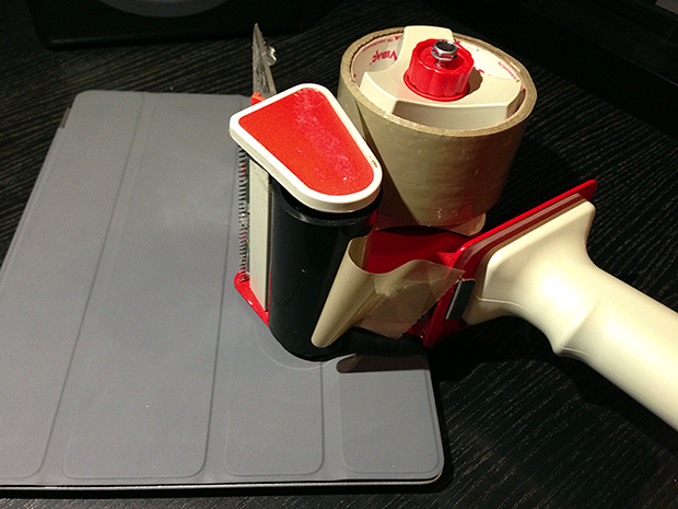 Attach a business card to your smartphone or tablet with tape